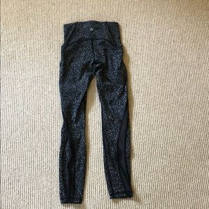 Black and white lululemon leggings, mesh siding